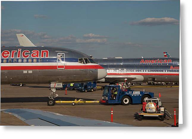 Passenger Airliners At An Airport Greeting Card by Jim West