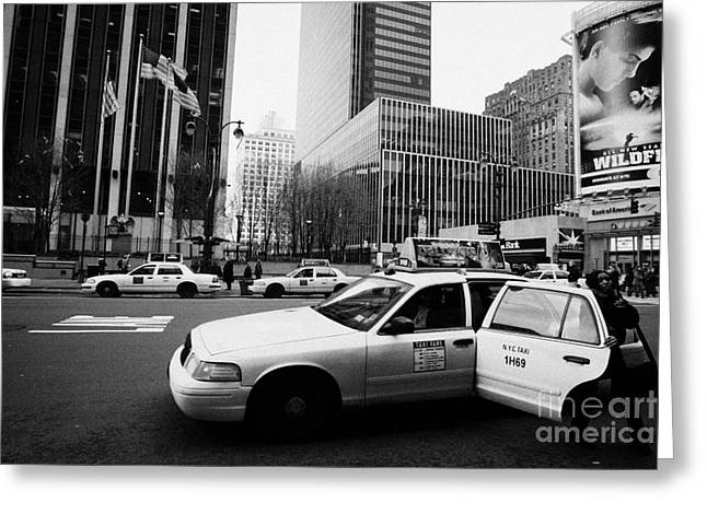 Manhaten Greeting Cards - Passenger Gets Out Of Rear Door Of Yellow Taxi Cab On 7th Avenue New York City Usa Greeting Card by Joe Fox