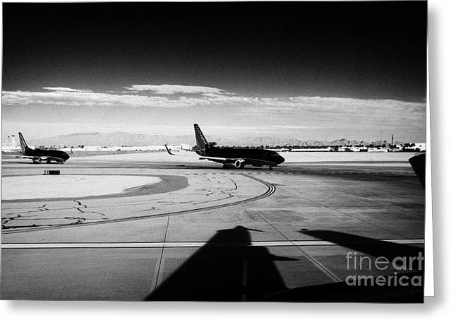 United Airlines Passenger Plane Greeting Cards - passenger jets waiting in line to take off at McCarran International airport Las Vegas Nevada USA Greeting Card by Joe Fox
