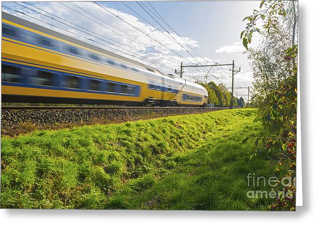 Limburg Greeting Cards - Passenger train moving at high speed in sunlight Greeting Card by Jan Marijs