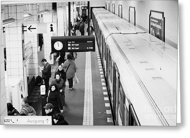 U-bahn Photographs Greeting Cards - passengers along ubahn train platform Friedrichstrasse Friedrichstrasse u-bahn station Berlin Greeting Card by Joe Fox