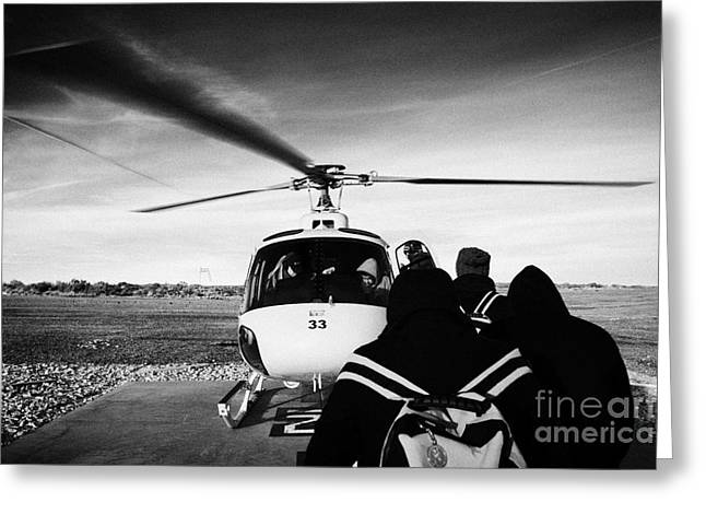 Helipad Greeting Cards - passengers boarding papillon helicopter tours on helipad at Grand canyon west airport Arizona Greeting Card by Joe Fox