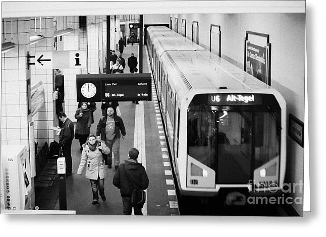 Berlin Germany Greeting Cards - passengers on ubahn train platform as train leaves Friedrichstrasse u-bahn station Berlin Germany Greeting Card by Joe Fox