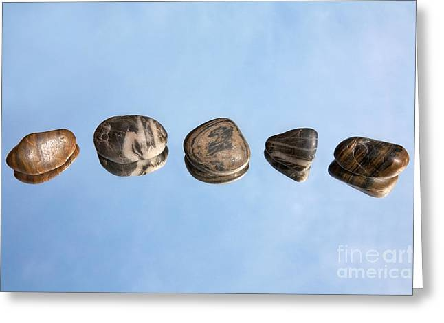 Pebbles And Sky Reflection Greeting Card by Natalie Kinnear