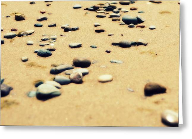 Pebbles on the Beach Greeting Card by Michelle Calkins