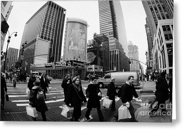 Manhatan Greeting Cards - Pedestrians Crossing Crosswalk On 7th Ave And 34th Street Outside Macys New York City Usa Greeting Card by Joe Fox