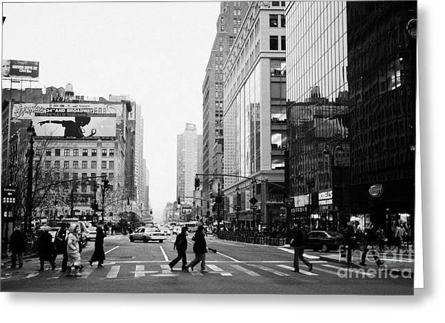 Pedestrians crossing crosswalk on west 34th street and sixth 6th avenue at herald square new york Greeting Card by Joe Fox