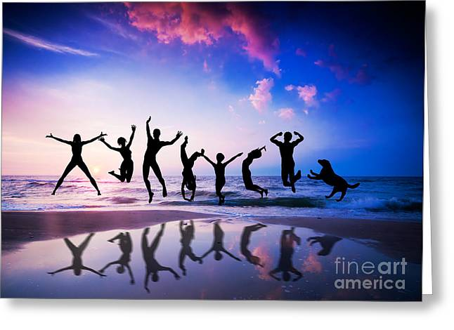 Senior Dog Greeting Cards - People and dog jumping on the beach Greeting Card by Michal Bednarek
