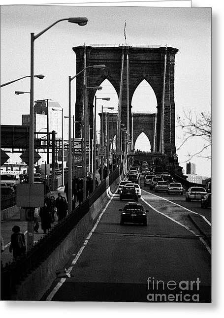 Manhaten Greeting Cards - people and traffic crossing the Brooklyn bridge in the evening new york city Greeting Card by Joe Fox