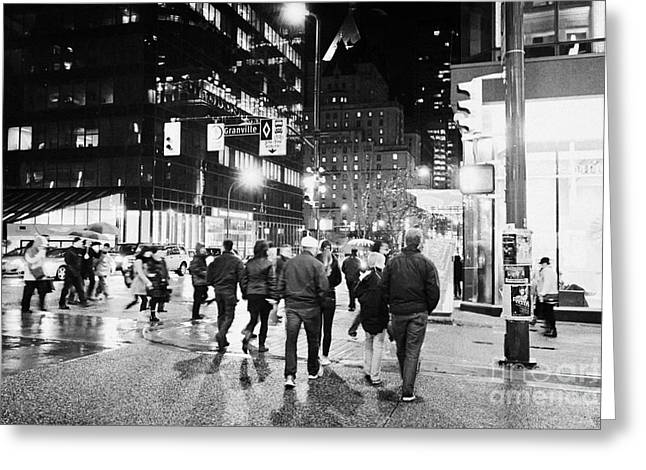 Crosswalk Greeting Cards - people crossing corner of granville and west georgia streets on a rainy night Vancouver BC Canada Greeting Card by Joe Fox