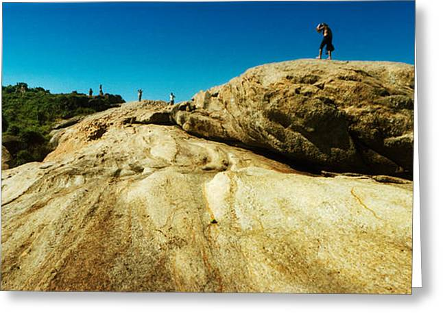 Beach Landscape Greeting Cards - People Hiking Along The Boulders That Greeting Card by Panoramic Images