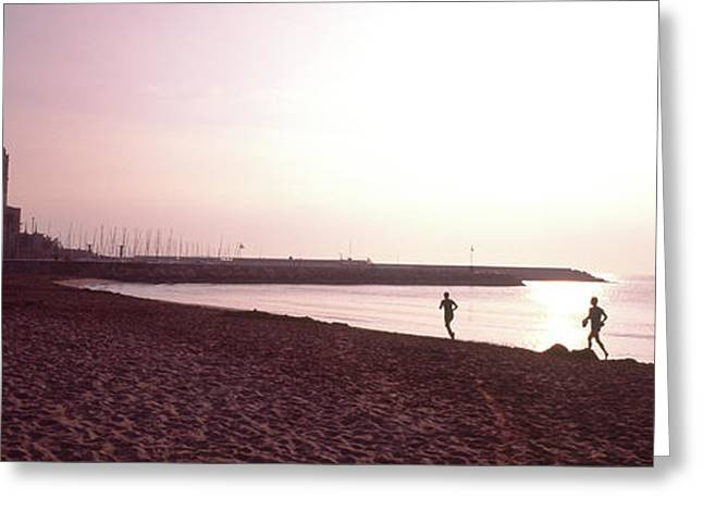 People Jogging On Beach, Sitges Greeting Card by Panoramic Images
