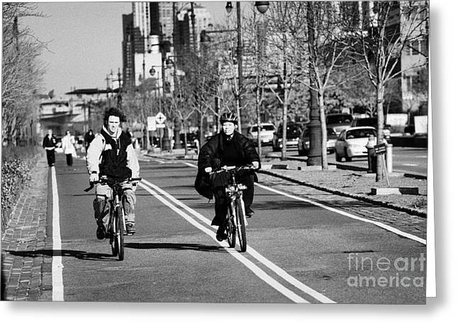 people mountain bikes exercising on bikeway next to West Side Highway new york Greeting Card by Joe Fox