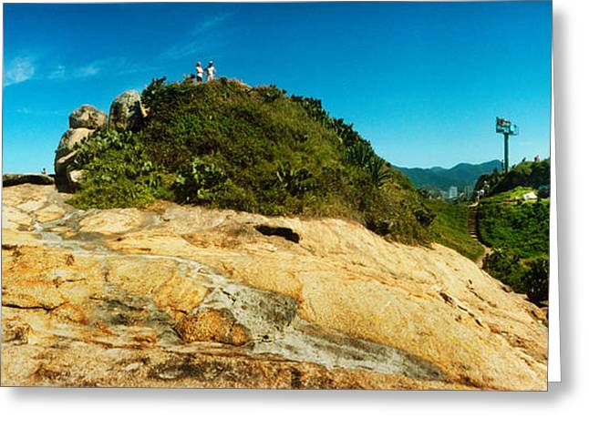 Beach Landscape Greeting Cards - People On Boulders That Separate Greeting Card by Panoramic Images