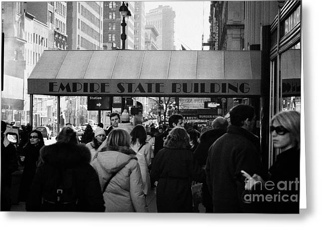 People On The Sidewalk Beneath The Entrance To The Empire State Building On Fifth Avenue New York Greeting Card by Joe Fox