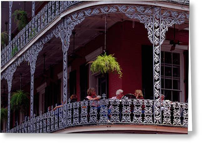 Residential Structure Greeting Cards - People Sitting In A Balcony, French Greeting Card by Panoramic Images