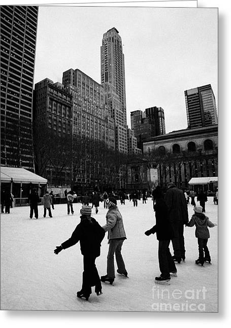 people skating on the ice at Bryant Park ice skating rink new york city Greeting Card by Joe Fox