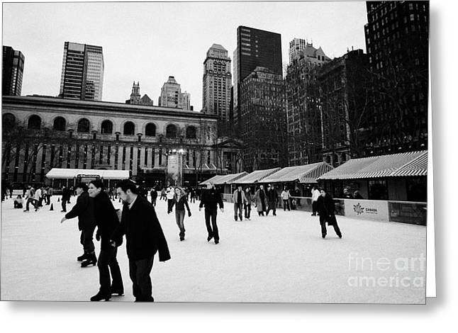 Manhatan Greeting Cards - people skating on the ice at Bryant Park ice skating rink new york Greeting Card by Joe Fox