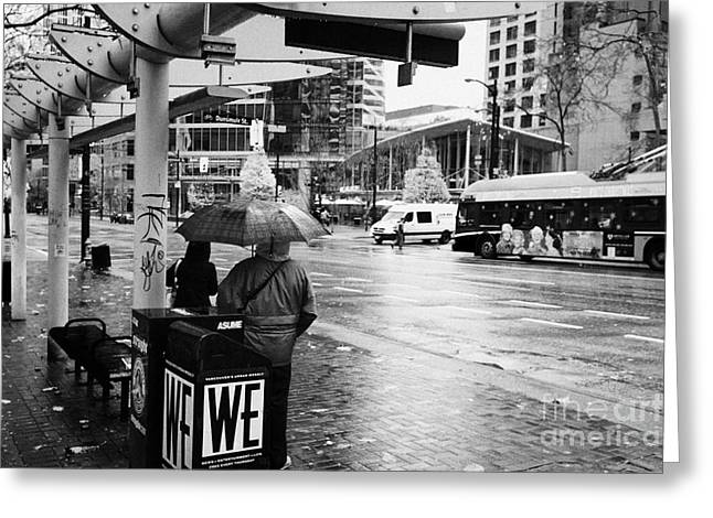 Busstop Greeting Cards - people standing in the rain waiting for a bus on burrard street downtown Vancouver BC Canada Greeting Card by Joe Fox