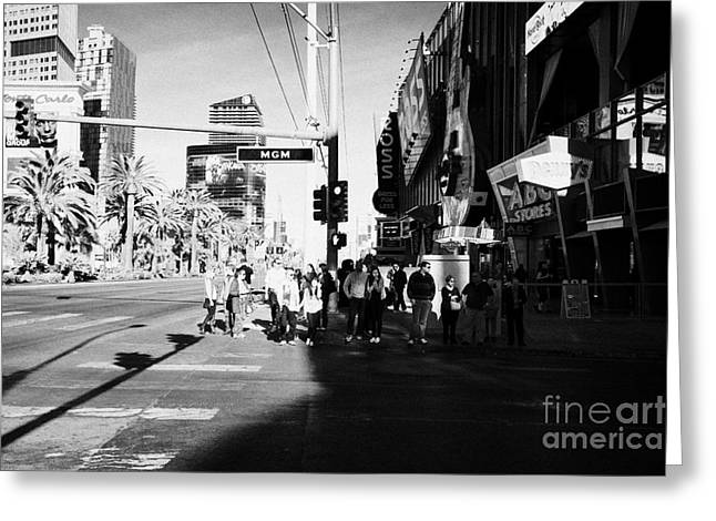people waiting to cross at intersection on south Las Vegas boulevard strip Nevada USA Greeting Card by Joe Fox