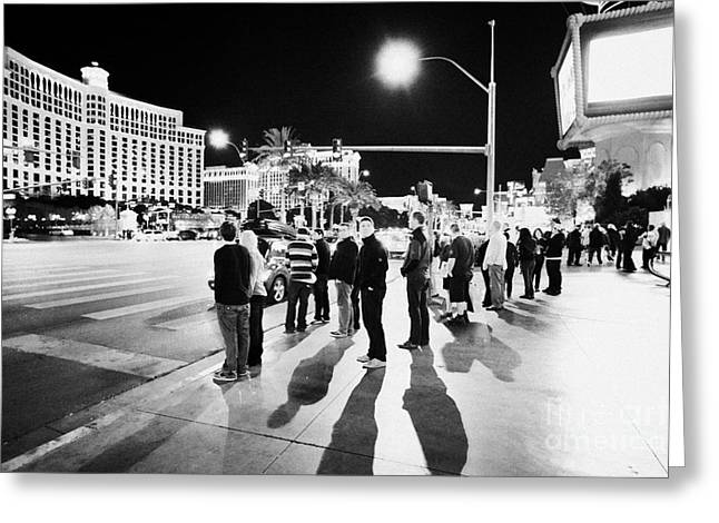 Crosswalk Greeting Cards - People Waiting To Cross Las Vegas Boulevard Outside The Bellagio And Paris At Night Nevada Usa Greeting Card by Joe Fox