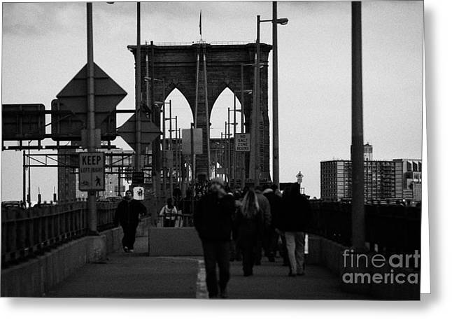 Manhaten Greeting Cards - People Walking Across The Brooklyn Bridge New York City Greeting Card by Joe Fox