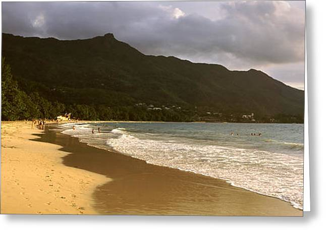 Panoramic Ocean Greeting Cards - People Walking Along The Beau Vallon Greeting Card by Panoramic Images