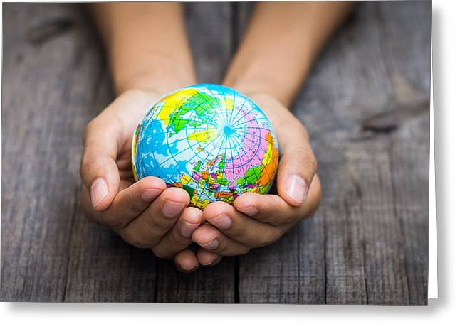 Planet Earth Photographs Greeting Cards - Person holding a world Greeting Card by Aged Pixel
