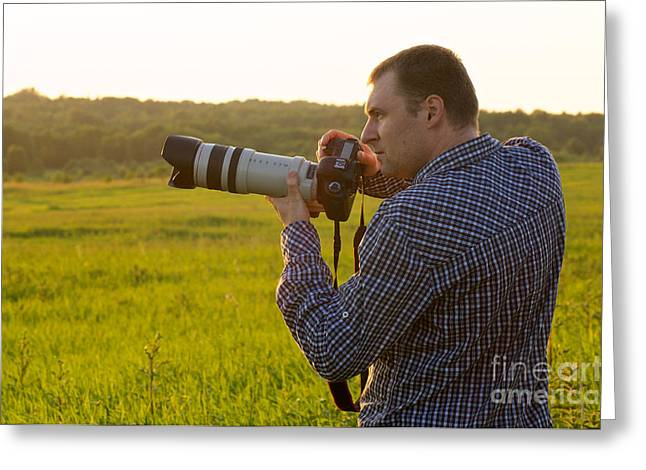 One Photograph Greeting Cards - Photographer with camera Greeting Card by Aleksey Tugolukov