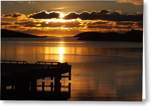 Reflection Of Sun In Clouds Greeting Cards - Pier In A Glowing Sunset Greeting Card by Anne Macdonald