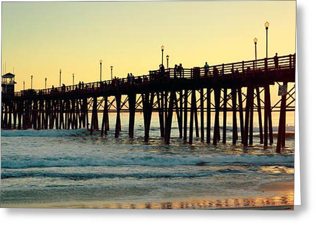 Panoramic Ocean Greeting Cards - Pier In The Ocean At Sunset, Oceanside Greeting Card by Panoramic Images