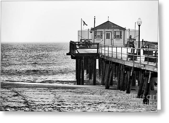 Snow. Ocean Greeting Cards - Pier in Winter Greeting Card by John Rizzuto