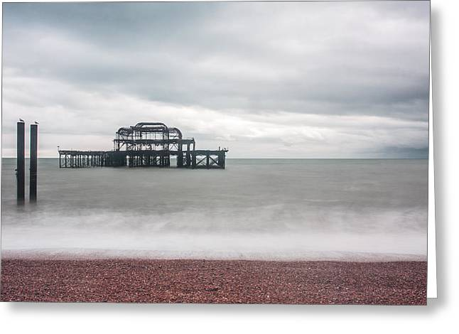Grey Clouds Greeting Cards - Pier Remains in Brighton Greeting Card by Semmick Photo