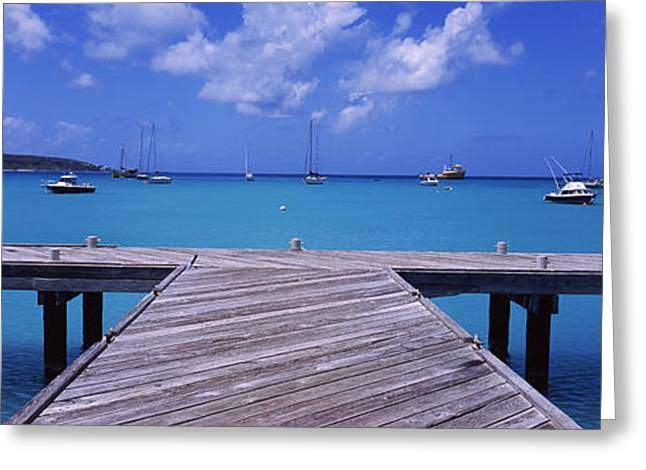 Water Vessels Greeting Cards - Pier With Boats In The Background Greeting Card by Panoramic Images