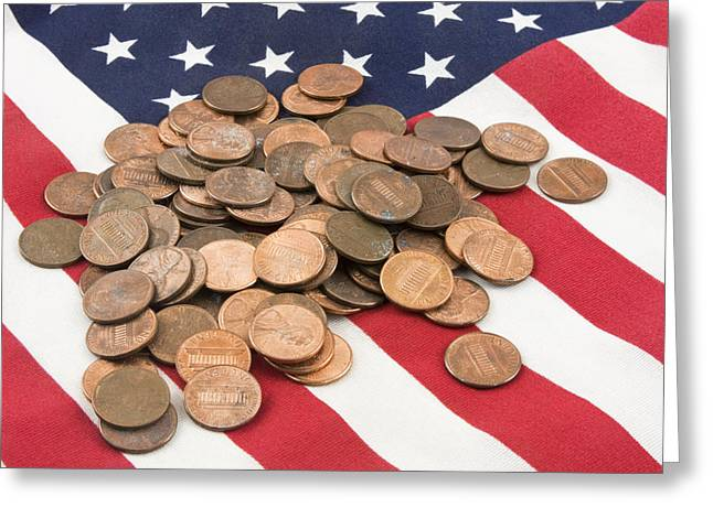 Financial Crisis Greeting Cards - Pile of Pennies On American Flag Greeting Card by Keith Webber Jr