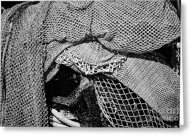 Port Holes Greeting Cards - pile of small mesh fishing nets in the port harbour of Cambrils Catalonia Spain Greeting Card by Joe Fox