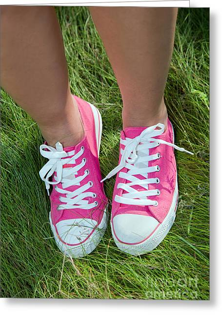 Sneaker Lace Greeting Cards - Pink sneakers on girl legs on grass Greeting Card by Michal Bednarek