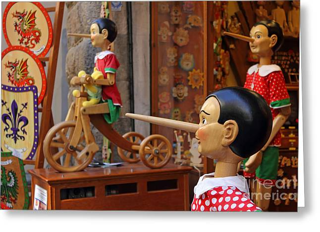 Toy Shop Greeting Cards - Pinocchio inviting tourists in souvenirs shop Greeting Card by Kiril Stanchev