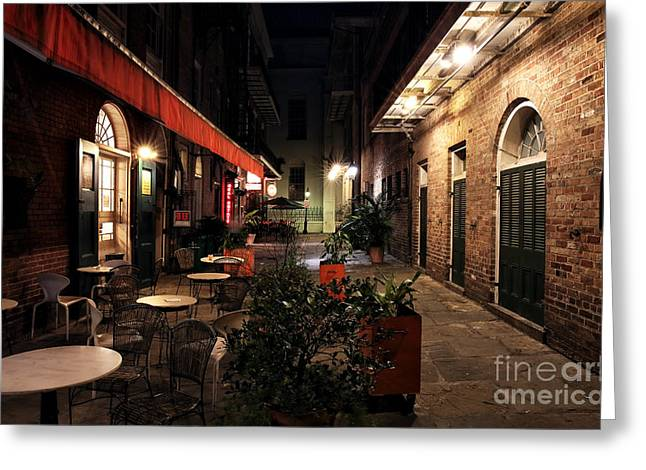 Pirates Alley at Night Greeting Card by John Rizzuto