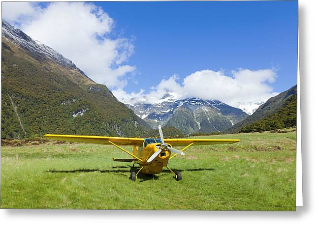 Airstrip Greeting Cards - Plane in the Valley Greeting Card by Alexey Stiop