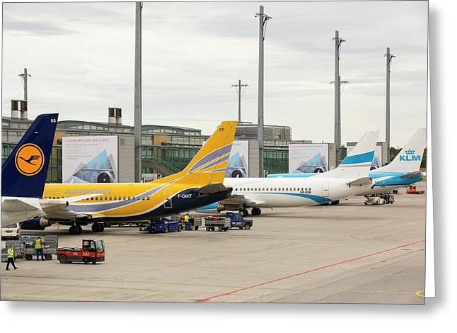 Planes On The Tarmac At Oslo Airport Greeting Card by Ashley Cooper