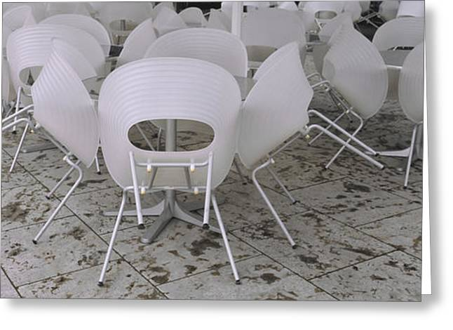 Plastic Chairs Around Tables In A Greeting Card by Panoramic Images