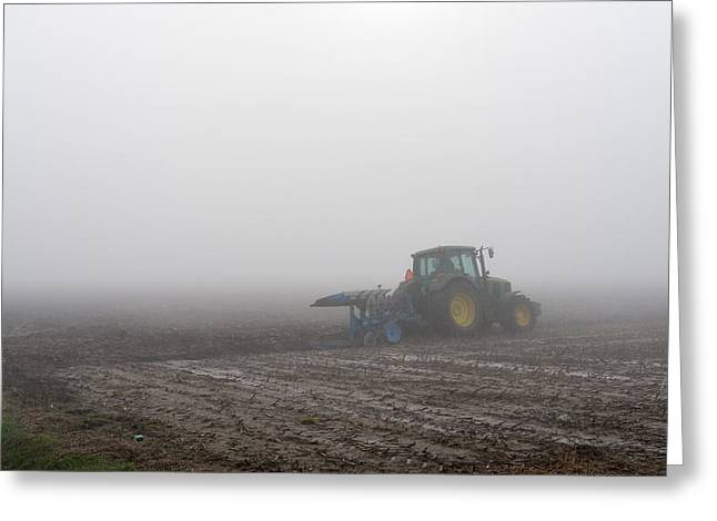 Mud Season Greeting Cards - Ploughing on a misty morning in the autumn season Greeting Card by Ruud Morijn