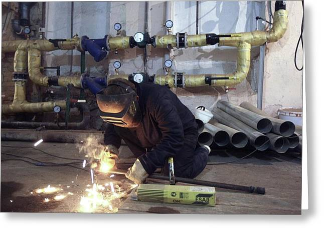 Bonding Greeting Cards - Plumber arc welding pipes Greeting Card by Science Photo Library