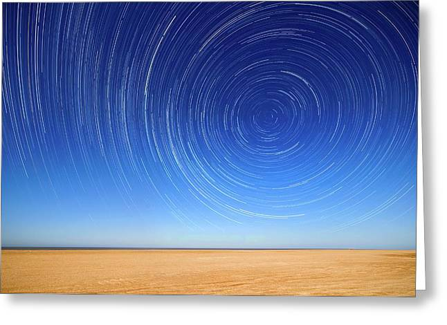 Polar Star Trails Over A Beach Greeting Card by Luis Argerich