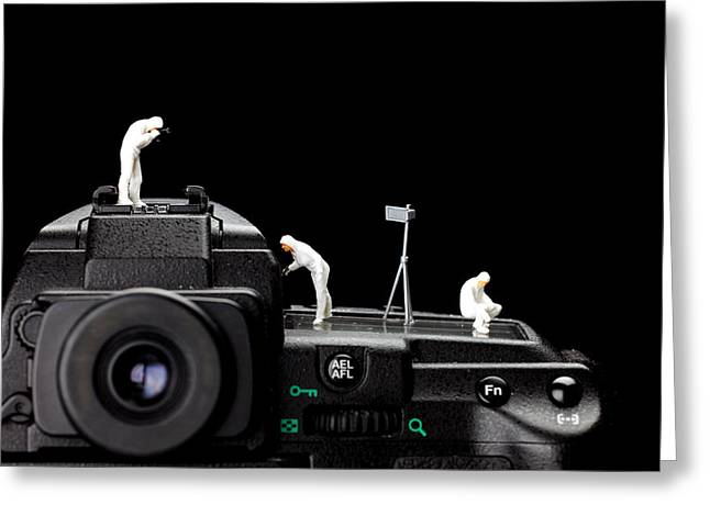 Police investigate on a camera Greeting Card by Paul Ge