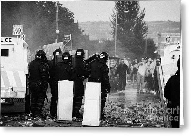 Police Officers In Riot Gear Face Rioters On Crumlin Road At Ardoyne Greeting Card by Joe Fox