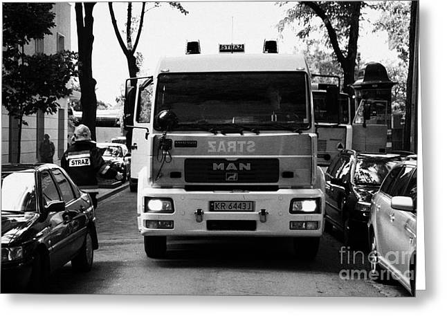 Polish City Greeting Cards - Polish Fire Brigade Fire Guard Straz Krakow Vehicle Parked In Middle Of City Street Firefighter Attending Emergency Call Out Greeting Card by Joe Fox