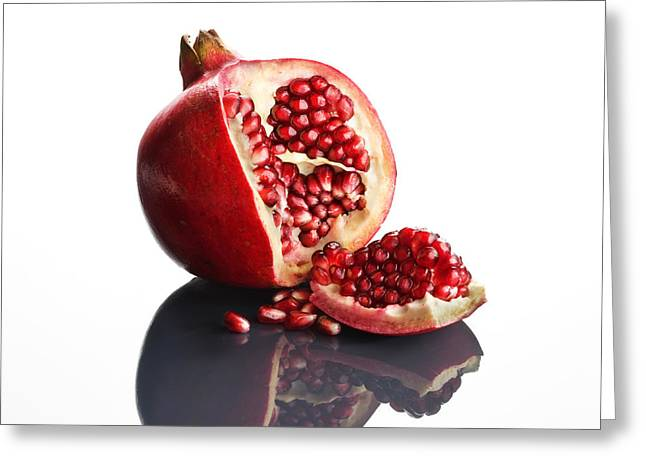 One Photograph Greeting Cards - Pomegranate opened up on reflective surface Greeting Card by Johan Swanepoel