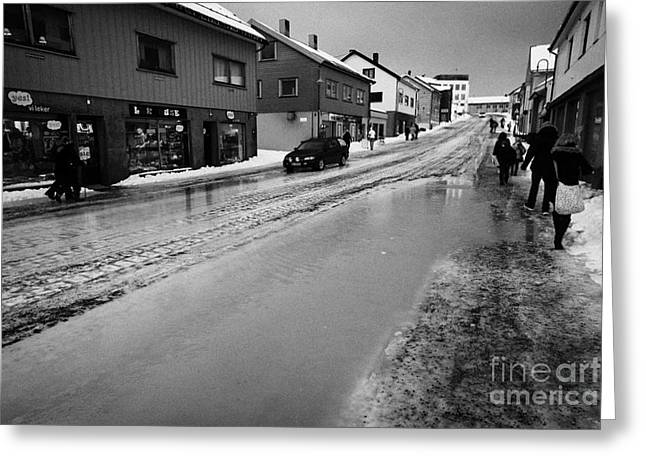 Flooding Greeting Cards - pools of thawing water from ice on main shopping street storgata Honningsvag finnmark norway europe Greeting Card by Joe Fox